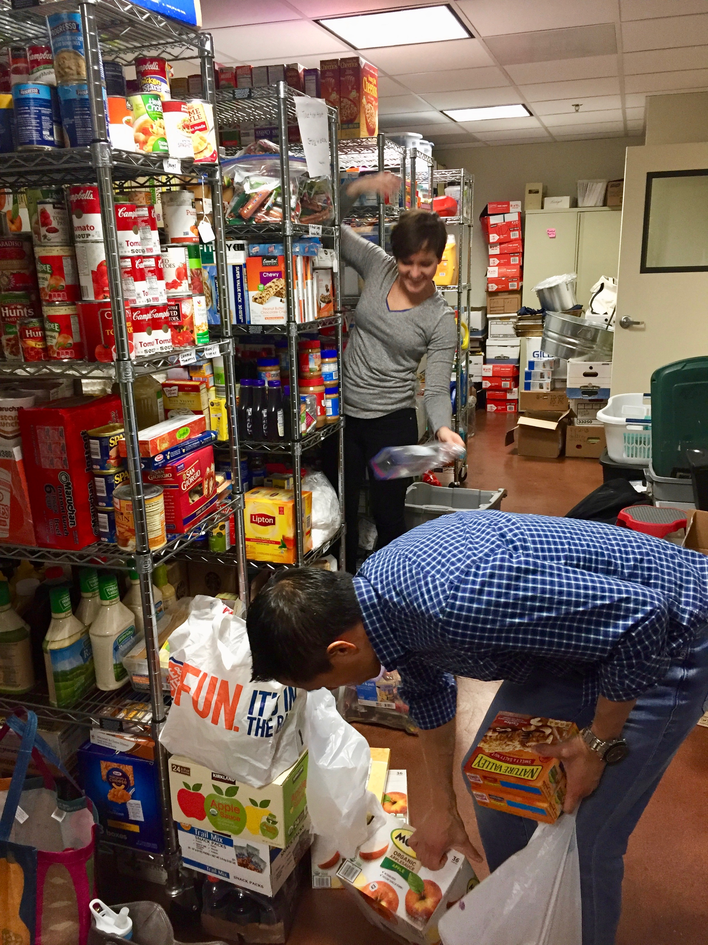 cleaning and organzing food donations - Red Team Consulting