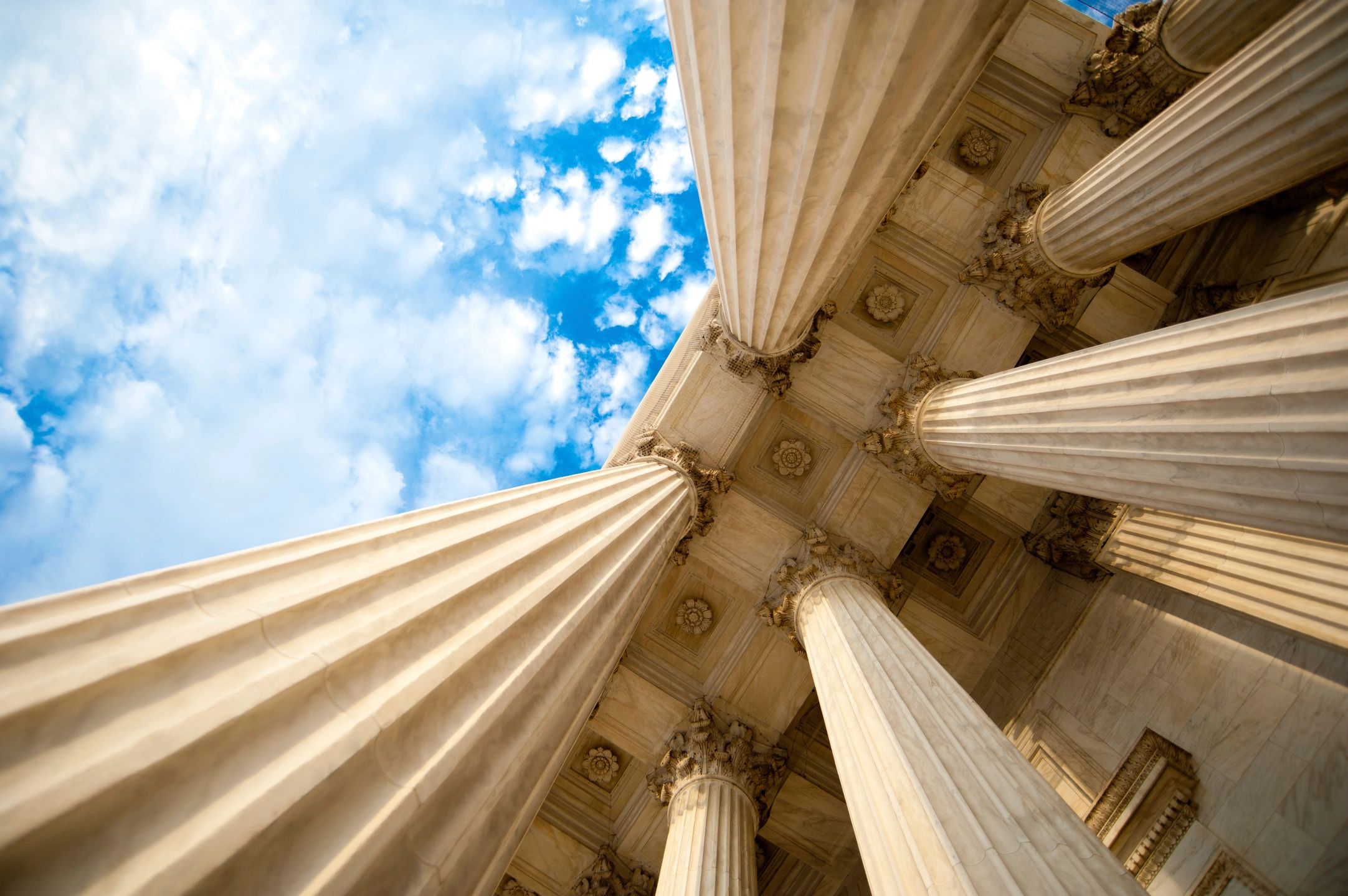 pillars and blue sky with clouds