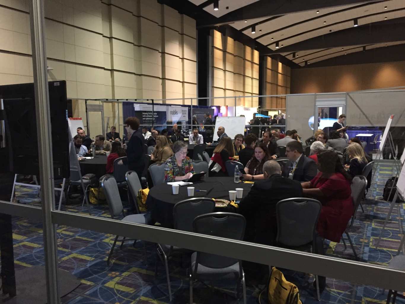 People networking at ACT-IAC's Imagine Nation ELC