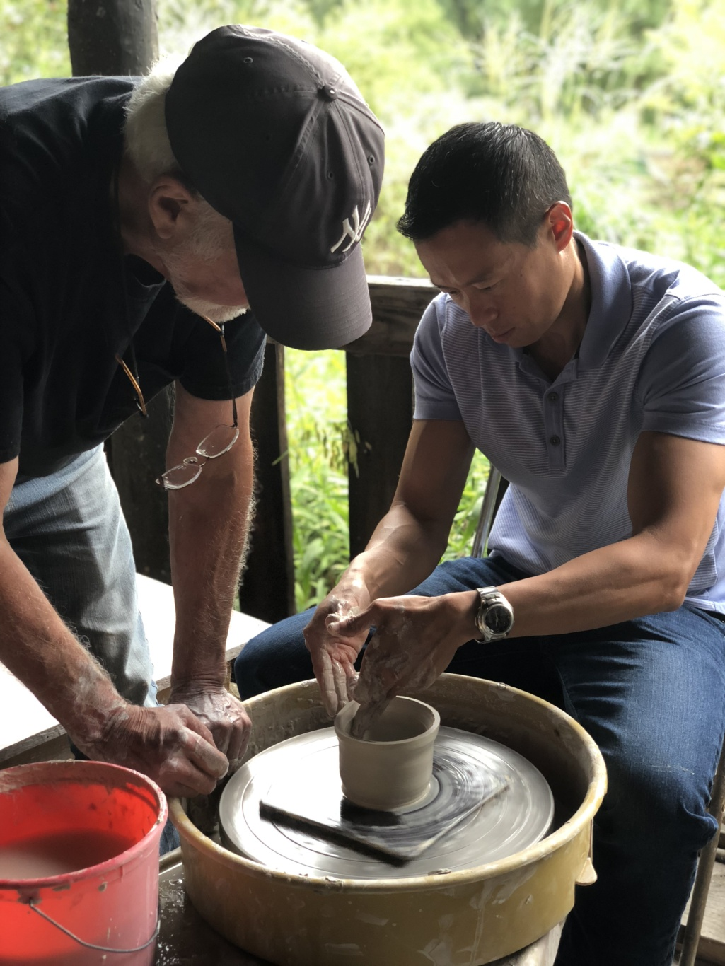 Jeff Shen and Richard Busch at a pottery wheel