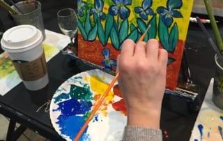Meghan Slipka painting at an easel