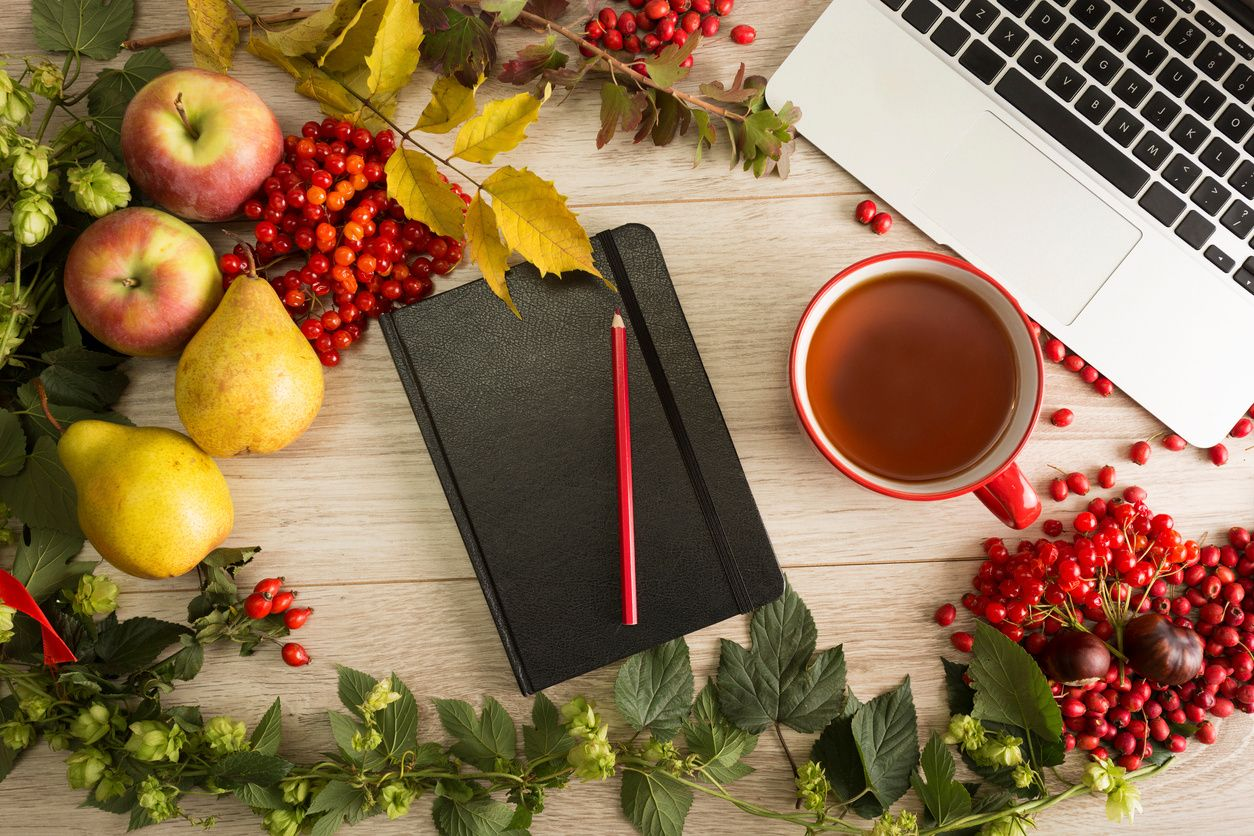 laptop and notebook with holiday decorations
